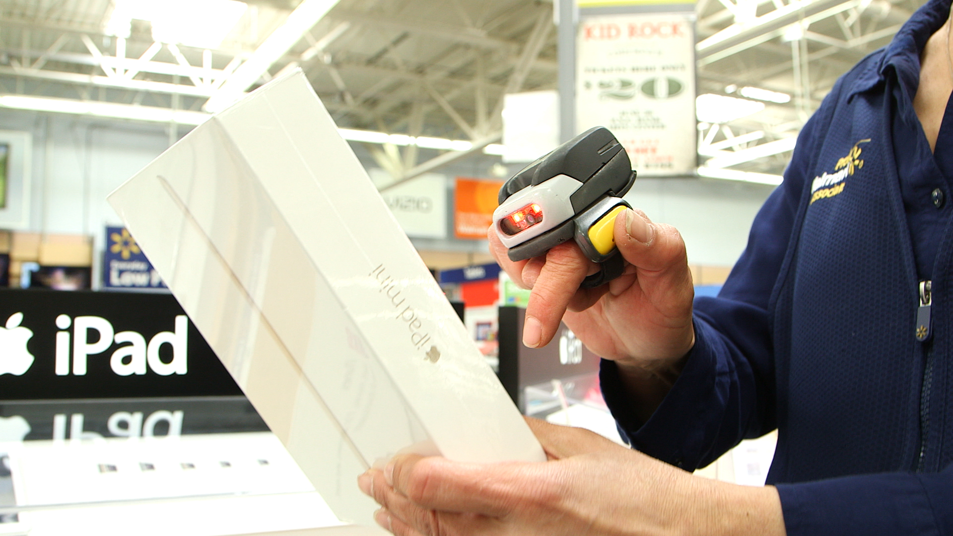 walmart e commerce fulfillment worker scanning ipad for ship from image