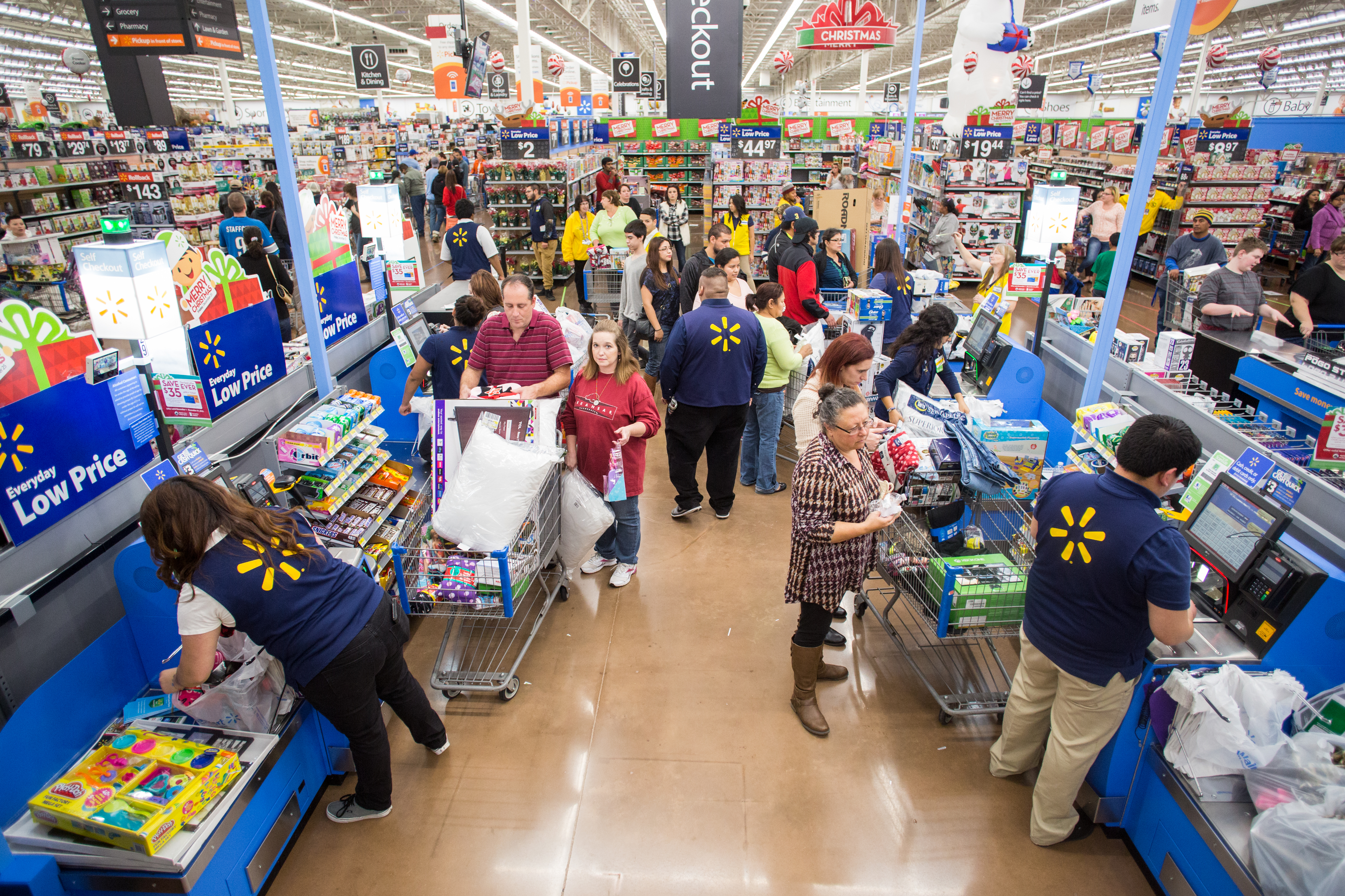 Customers checkout after shopping Walmart's Black Friday event on ...